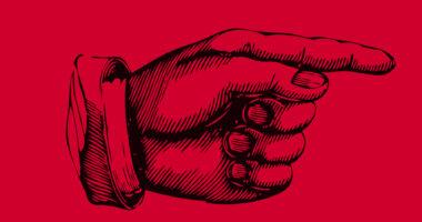 Dłoń z palcem wskazującym w prawo na czerwonym tle